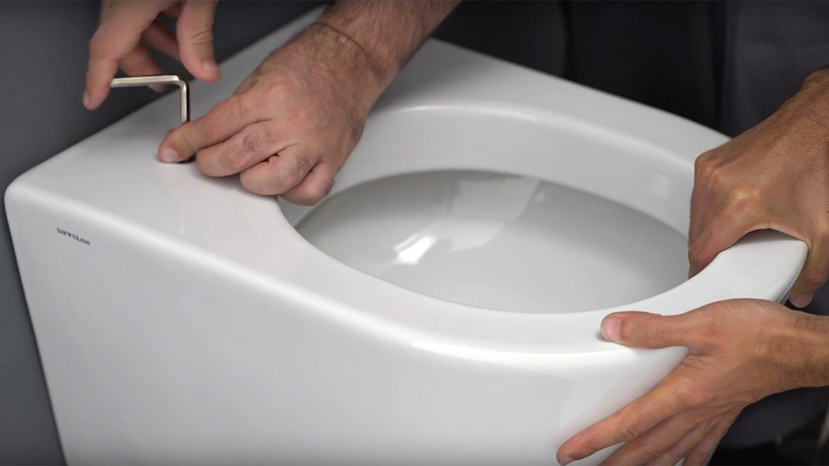 How to install a toilet with concealed fixation?